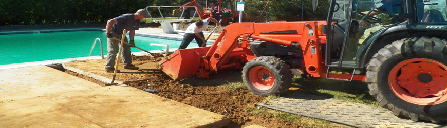Bobcat driving on alturna mats